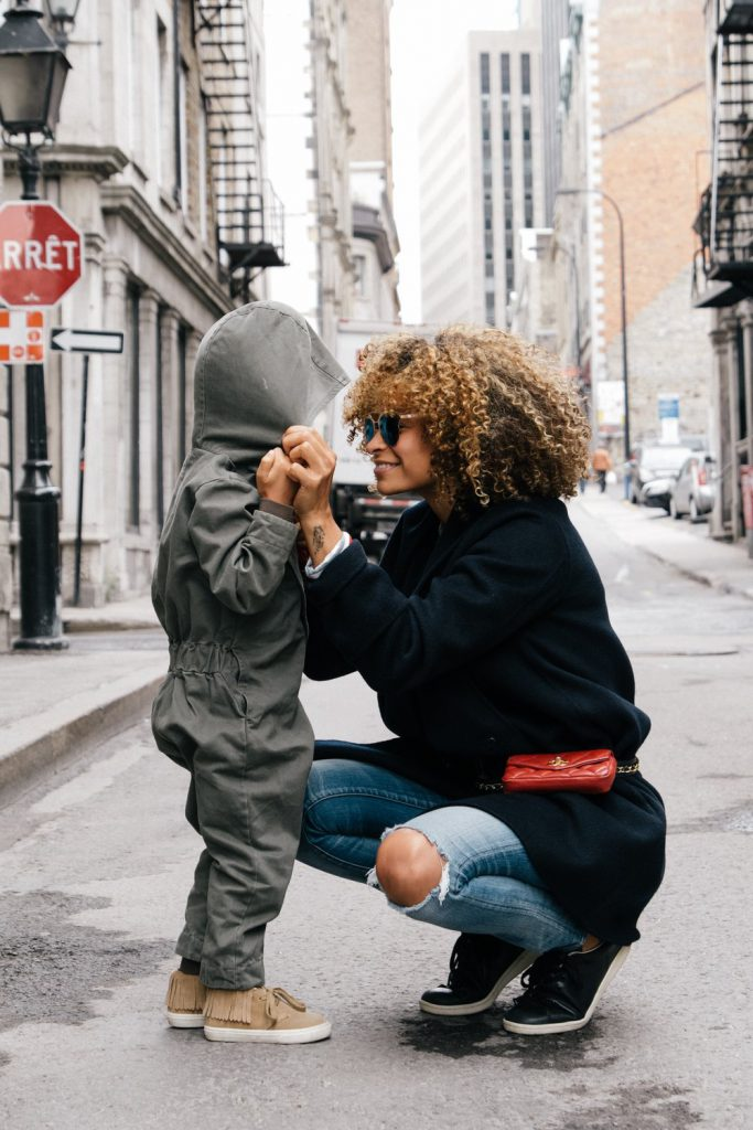 Curly mom with hooded child