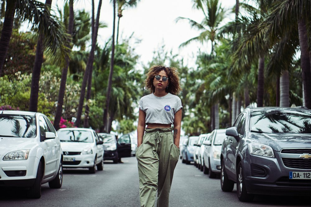 Girl with crop top walking in street