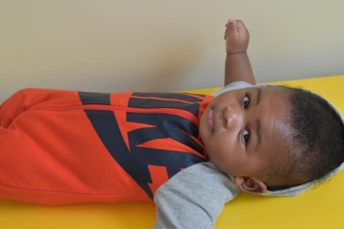 Baby on yellow dresser