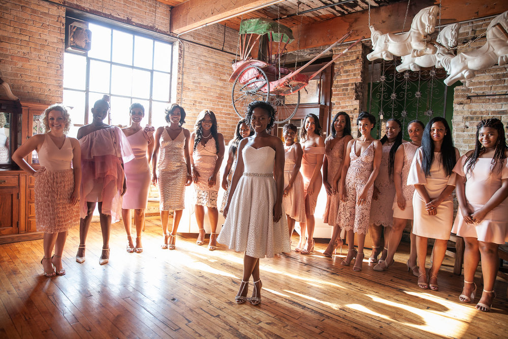 Bridal party surrounds bride