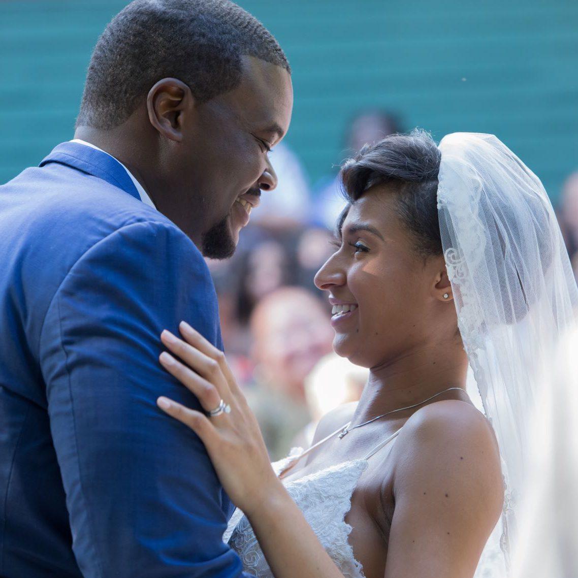Bride hugs groom and smiles