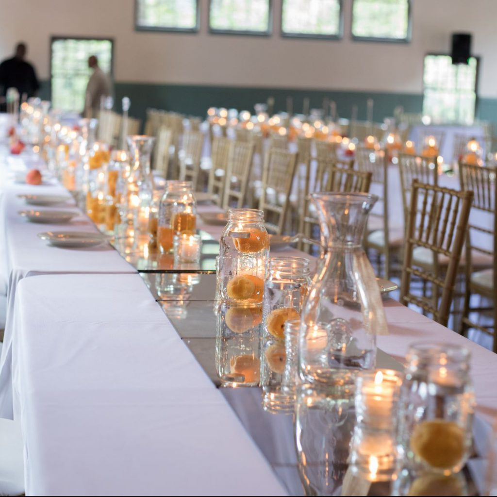 Wedding centerpieces with apricots and candles