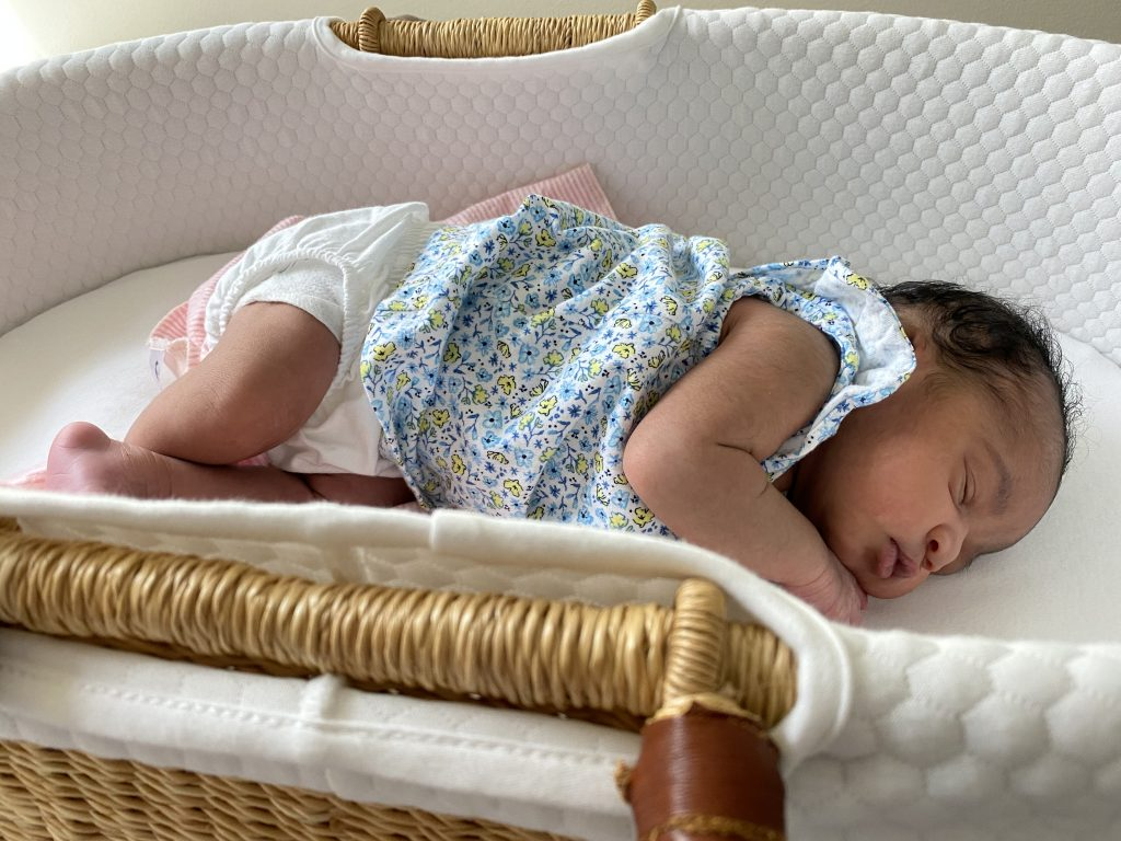 Baby in wicker bassinet
